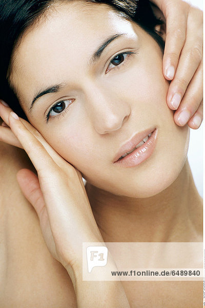 1231946 indoor studio young woman brunette people 25-30 beauty care hand hands touch face close up vertical portrait