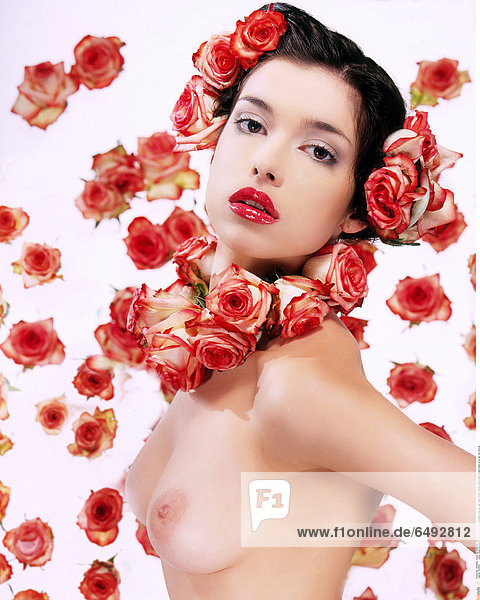 1234565 indoor studio people woman young girl 20-25 brunette close up rose roses flower flowers bust breast breasts make up lip lips red vertical