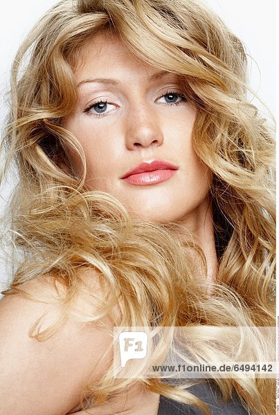 1239433 indoor studio woman young blonde long haired make up portrait close up blouse grey smile smiling vertical people
