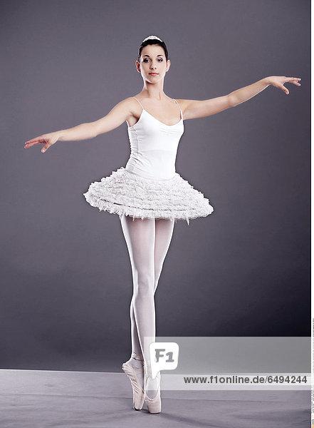 1237008 indoor people woman brunette young 25-30 ballerina ballet dance show representation play vertical dress white vertical stand leggings bun dancer