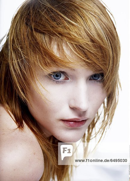 1238759 indoor studio people woman young 20-25 girl blonde long haired close up fringe rest relax vertical portrait