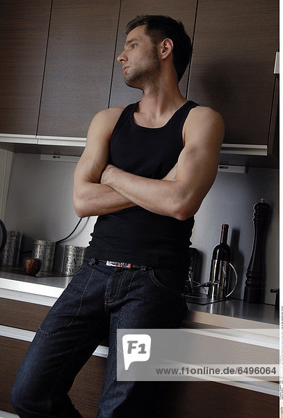 1243847 indoor flat kitchen people man young dark haired 25-30 beard blouse black close up sad sadness think vertical