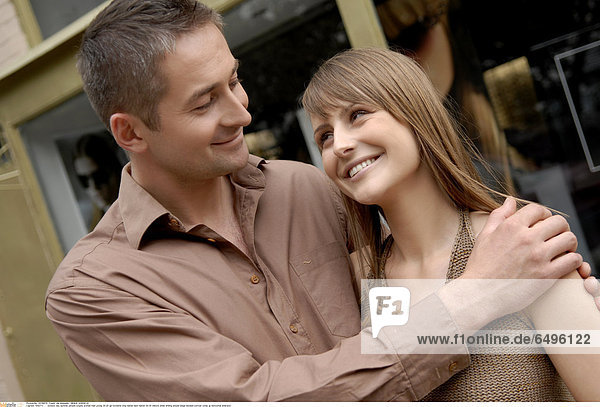 1243771 outdoor day summer people couple woman man young 20-25 girl brunette long haired dark haired 30-35 mature smile smiling blouse beige blouses portrait close up horizontal embrace