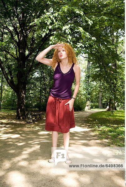 1247286 outdoor day summer park people woman young girl 20-25 blonde long haired blouse violet dress red rest relax walk close up portrait vertical look for