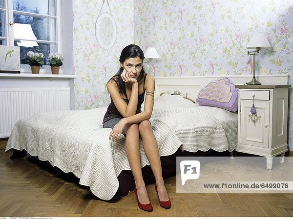 1248441 people woman 20-25 25-30 brunette dark haired tatoo sit bed bedroom indoor horizontal