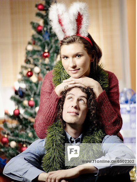1260342 Portrait of a young couple during Christmas.