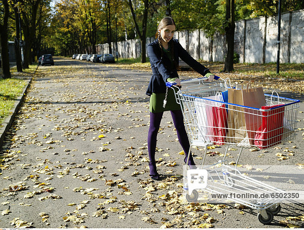 1260446 Young girl in the park in autumn