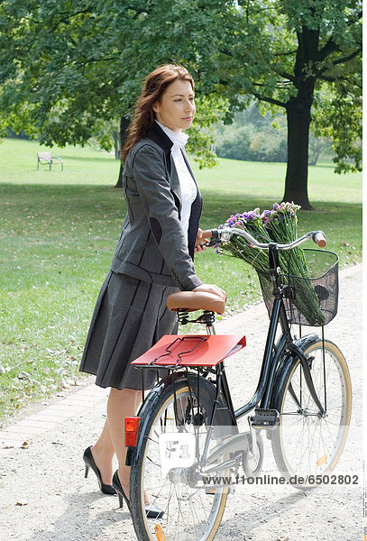 1260108 Woman on a bicycle.