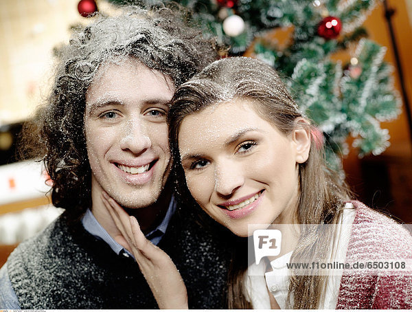 1260364 Portrait of a young couple during Christmas.