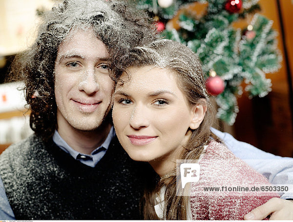 1260363 Portrait of a young couple during Christmas.