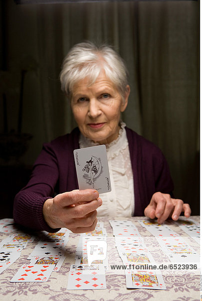 Old lady telling fortunes by cards