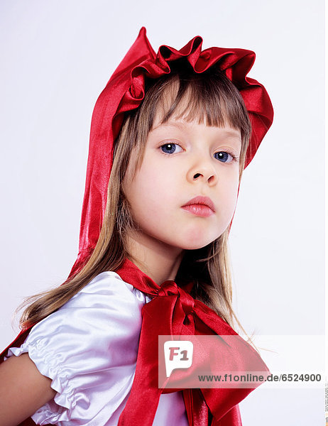 Girl wearing Little Red Riding Hood costume