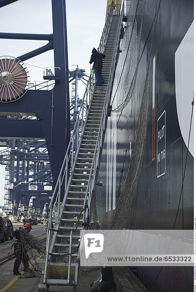 Mandatory Credit: Photo by Rex Features ( 1293974aj ) Ship workers on container ship docked at Felixstowe port  Britain. Various