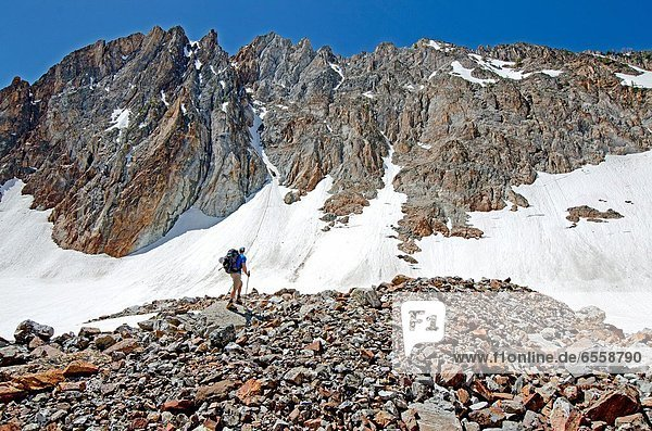 Elijah Weber below The June Couloir on the North Face of Williams Peak high above the Sawtooth Valley in the Sawtooth Mountains near the town of Stanley in central Idaho