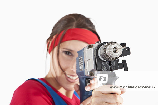 Young woman holding electric drill  portrait