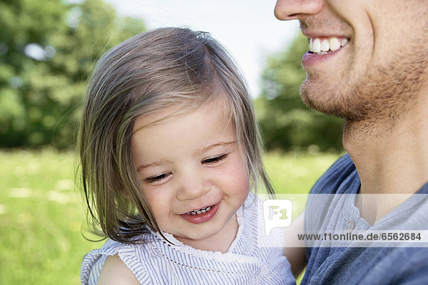 Gemany  Cologne  Father and daughter smiling  close up