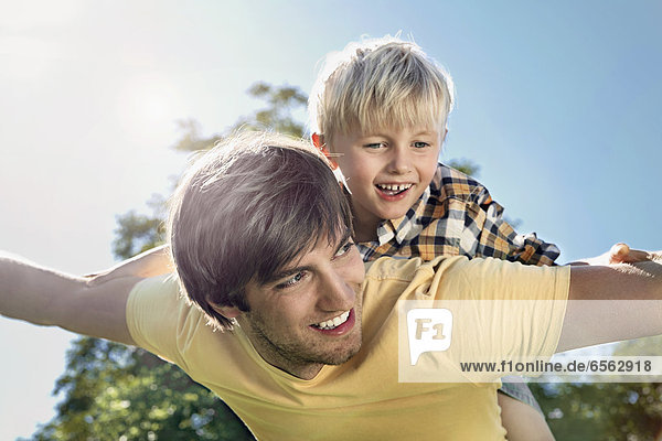 Germany  Cologne  Father and son flying  smiling