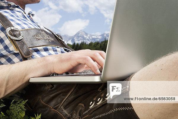 Mid adult man using laptop Mid adult man using laptop