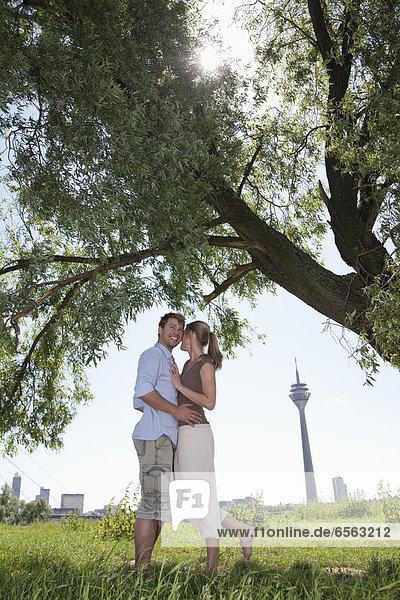Germany  North Rhine Westphalia  Duesseldorf  Couple embracing  smiling