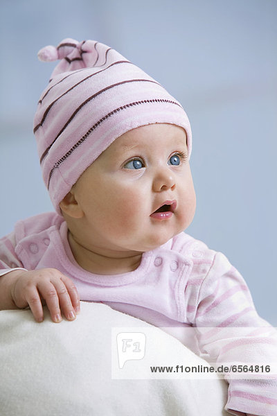 Baby girl in woolly hat  close up