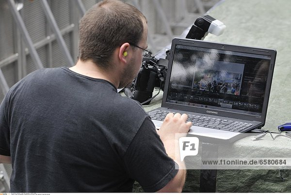 Press photographer transmitting his pictures to the redaction trough the Internet.