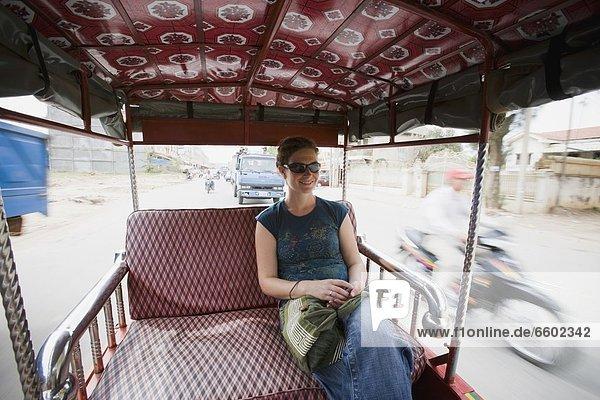 Young Woman Riding In Tuk-Tuk In Phnom Penh  Cambodia.