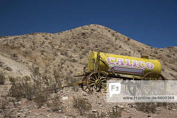 A water wagon at Calico Ghost Town  an 1880s silver mining town in the Mojave Desert that has been restored as a tourist attraction  Barstow  California  USA