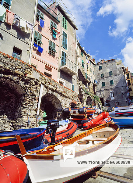 The Village Of Riomaggiore With Row Boats In The Foreground.