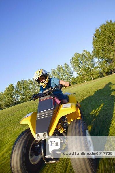Child Rides A Quad