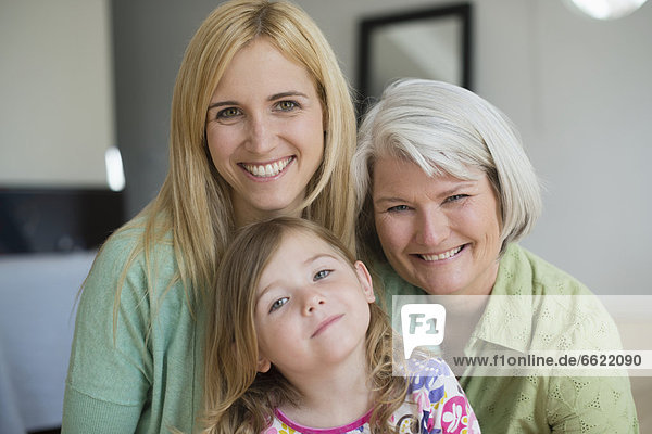 Smiling Caucasian grandmother  mother and daughter