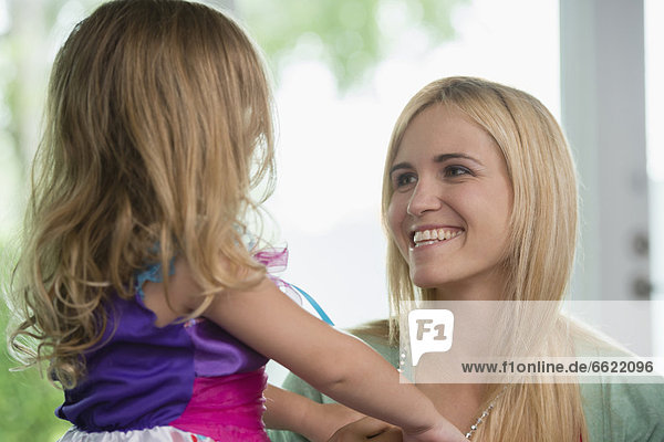 Smiling Caucasian mother and daughter
