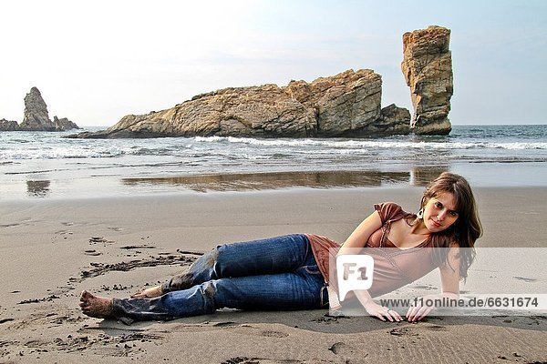Attractive young Woman at El Sablón beach  Asturias  Spain
