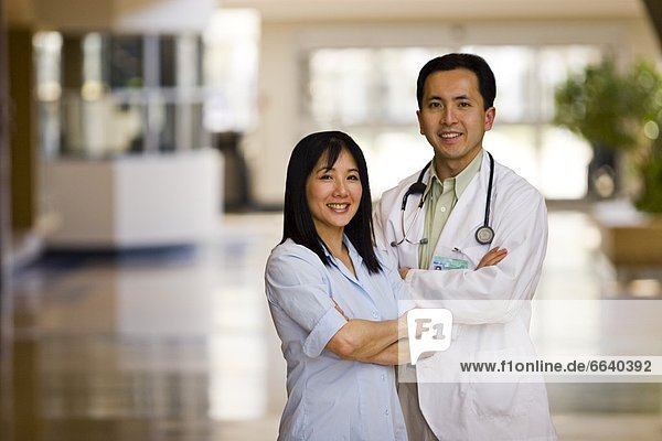 Doctor And Nurse Portrait In Medical Facility