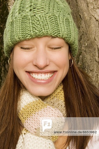 Smiling Woman With Toque And Scarf