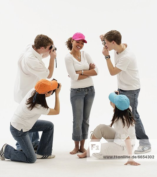 A Group Of Teens Taking Pictures