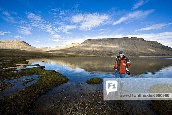 stehend  Ecke  Ecken  Mensch  See  Kanada  Nunavut