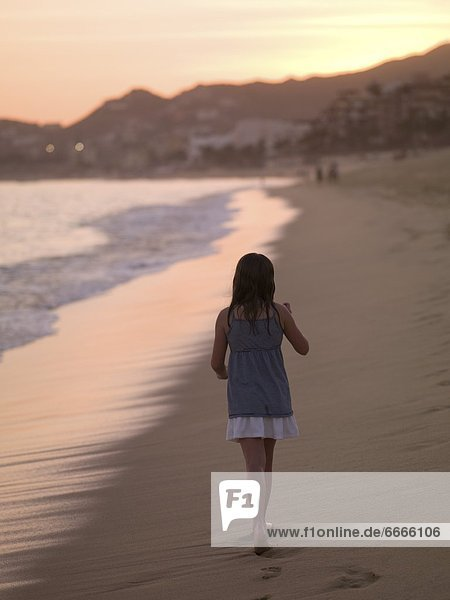 Girl Walking On The Beach In Los Cabos  Mexico