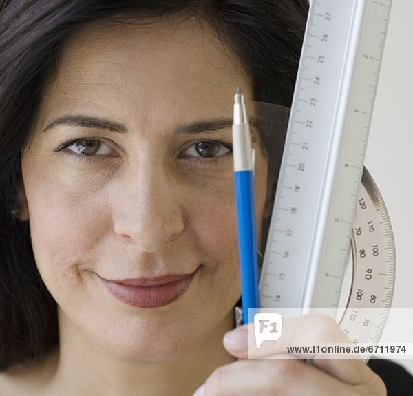 Woman holding ruler  protractor and pencil