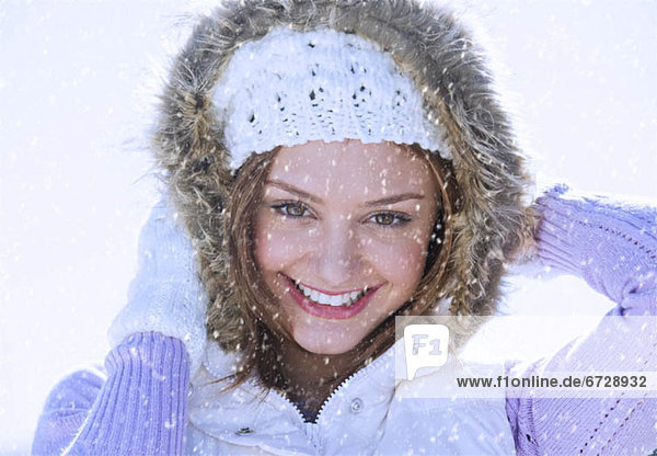 USA  New Jersey  Jersey City  Portrait of young woman wearing white knitted hat