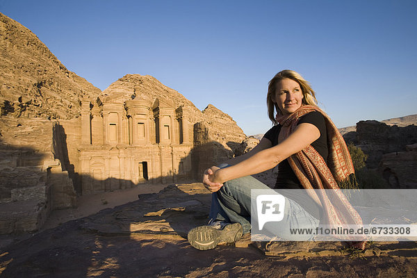 'A Woman Tourist Visits The Nabatean Ruins Of The Monastery