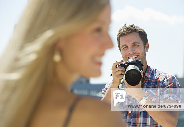 Photographer taking picture of woman