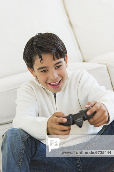 Girl (12-13) playing video games