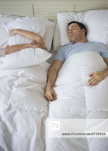 Couple in bed  man snoring