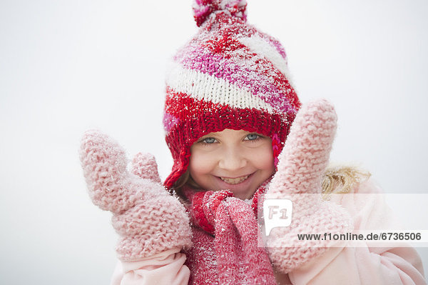 Portrait of smiling girl (8-9) wearing winter clothing