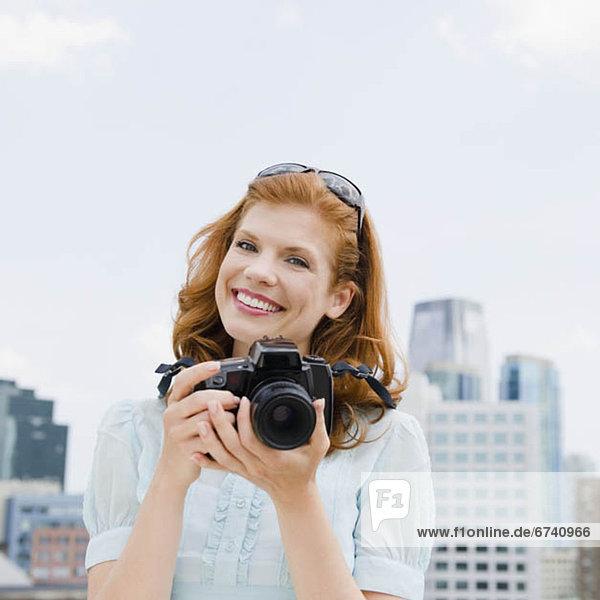 Woman taking a photograph