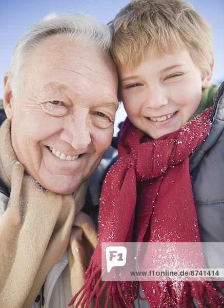 Portrait of grandfather with grandson (8-9) in winter