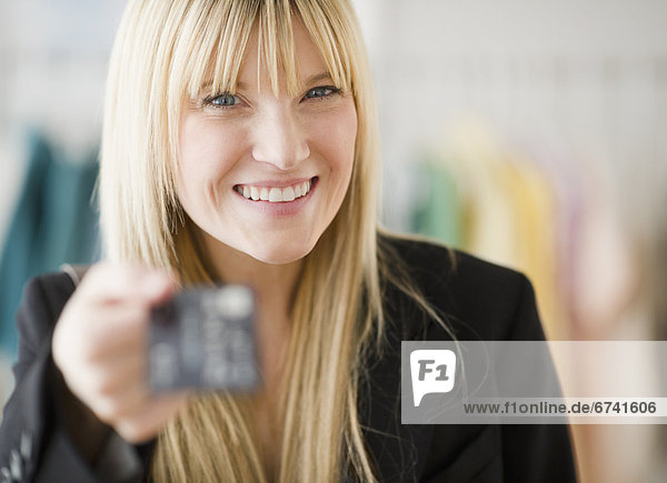 USA  New Jersey  Jersey City  young woman holding credit card