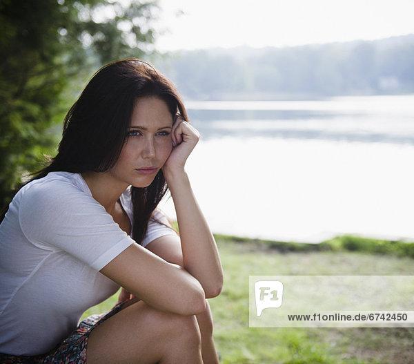 Roaring Brook Lake  Lonely woman sitting by lake