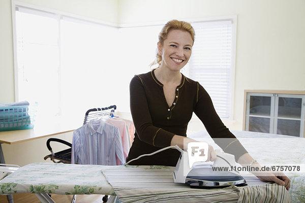 Woman ironing clothing