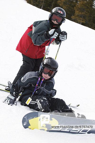 Snowboardfahrer  Skifahrer  Ende  Hang